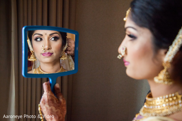 Gorgeous bride getting her Ghoonghat put on.  Gorgeous bride get