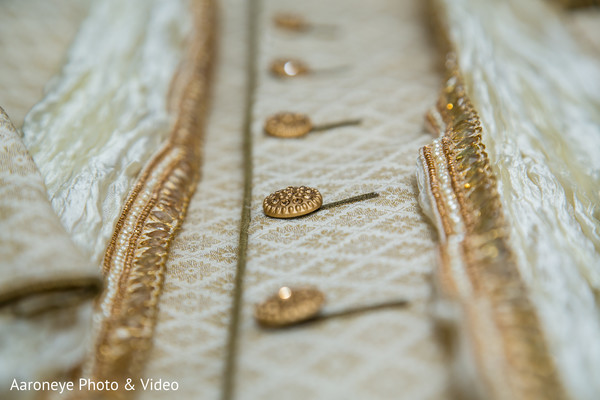 Closeup capture of details of Indian groom's sherwani.