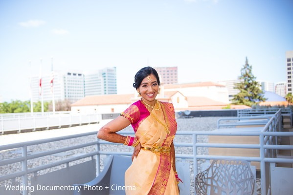 Indian bride  posing with their ceremony Anarkali outfit.