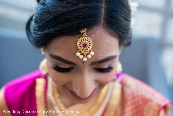 Lovely Indian bride wearing her Tikka closeup capture.