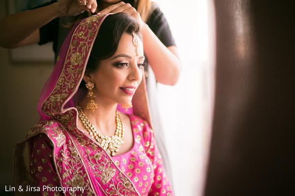 indian bride ghoonghat,indian bride jewelry,indian bride's ceremony fashion,indian bride hair and makeup