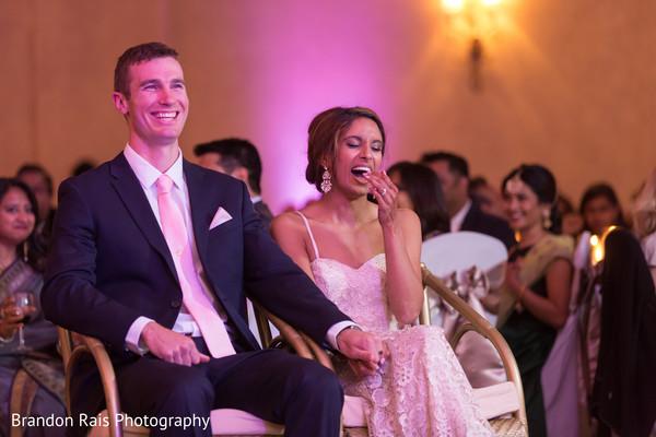 Charming Indian bride and groom enjoying wedding reception.