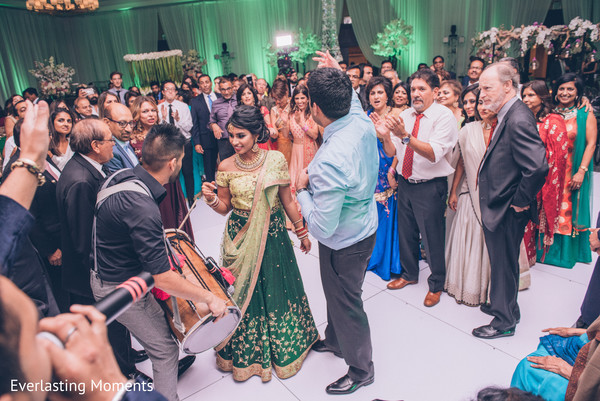 Joyful Indian Dholy play capture at wedding reception.