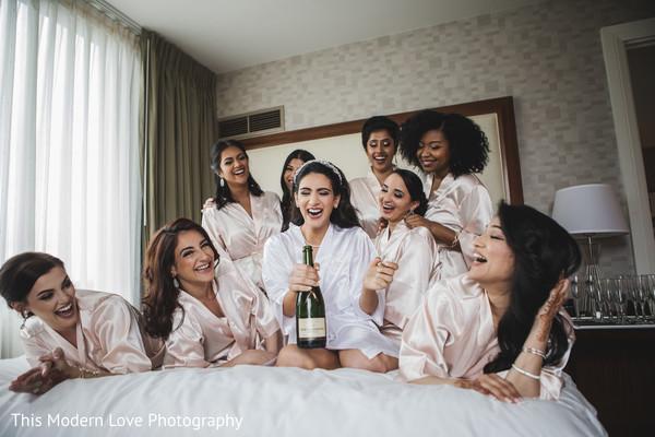 Joyful capture of indian bride with bridesmaids