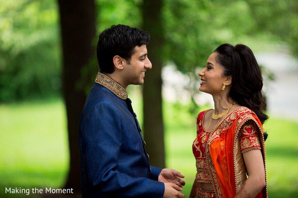 Joyful Indian bride and groom looking at each other.