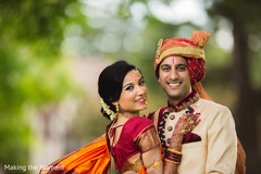 Gorgeous Indian bride and  groom looking at camera capture.