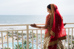 Marvelous Indian bride posing out the window.