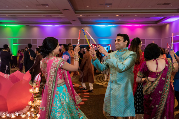 indian wedding garba,indian pre-wedding fashion,indian pre-wedding celebration,indian bride and groom