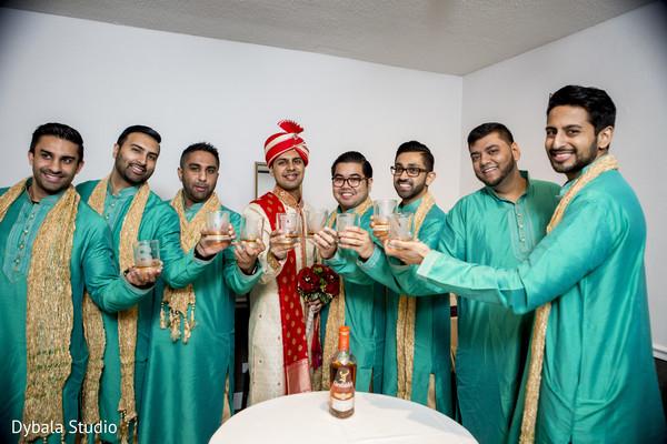 Indian groom toasting with groomsmen