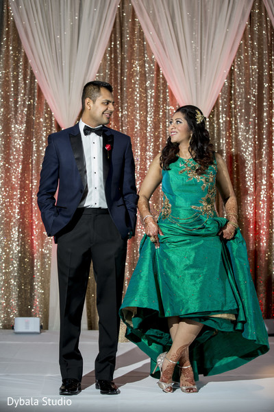 Lovely couple in their reception outfits