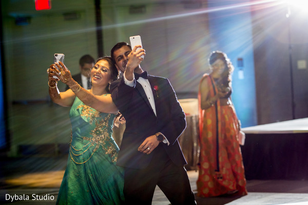 Indian newlyweds taking a selfie