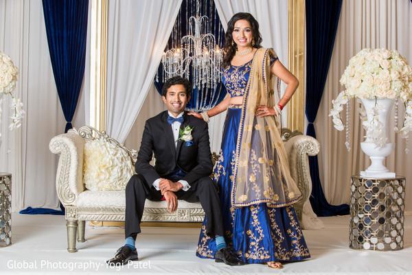 Glowing bride and groom on their Indian wedding reception fashion.