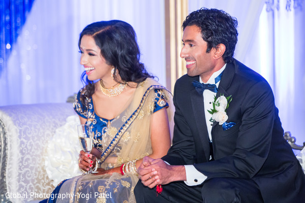 Adorable Indian bride and groom smiling capture.