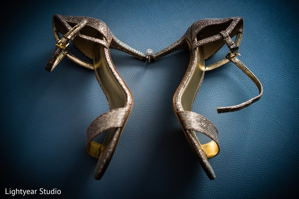 Marvelous capture of Indian bride's engagement ring with wedding shoes.
