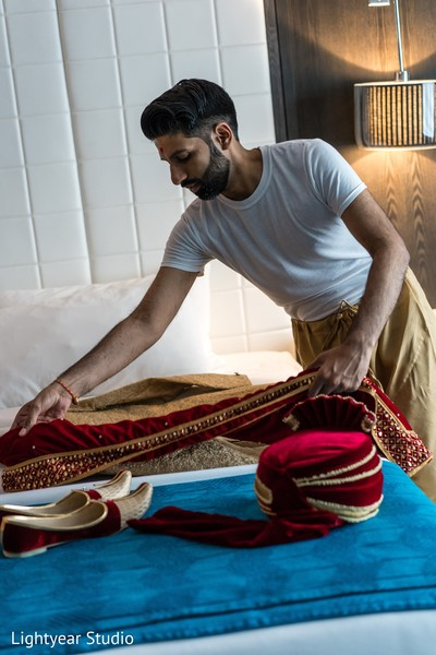 Indian groom getting his wedding accessories ready for wedding ceremony.