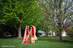 Indian lovebirds posing for photo shoot.