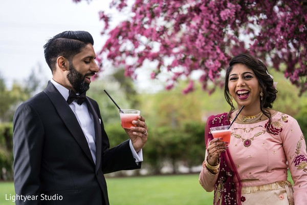 Fun capture of Indian bride and groom having a drink
