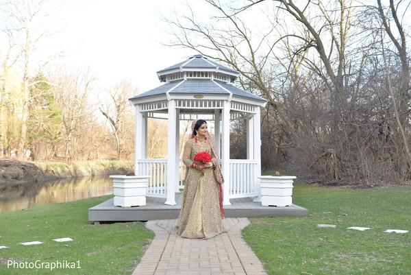 Ravishing Indian bride posing outdoors.