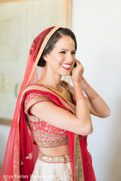 Lovely Indian bride getting her earrings on.