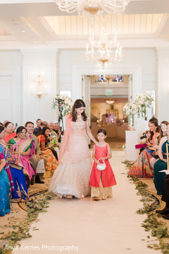 Lovely Indian wedding flower girl and bridesmaid portrait.