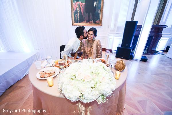 indian bride and groom,indian wedding flowers,indian wedding table setup