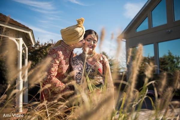 Indian bride and groom tender moment.