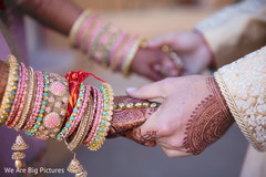 Sweet shot of Indian couple walking holding hands.