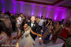 Gorgeous Indian bride and groom rocking the dance floor.
