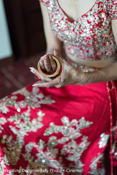 Indian bride putting bangles capture.