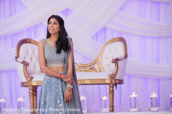 Lovely Indian bride enjoying her wedding reception capture.