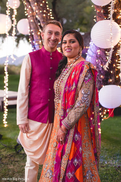 Gorgeous Indian couple on their sangeet outfits.