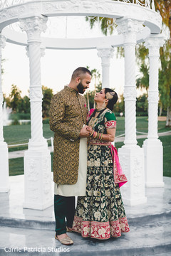 Lovely Indian bride and groom with their wedding sangeet outfits.