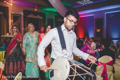 Indian Dhol player capture at the sangeet party.