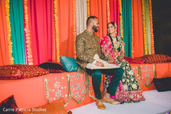 Indian bride and groom on their garba mandap capture.