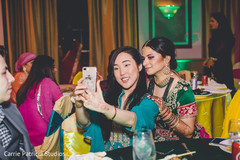 Indian bride posing with friend .