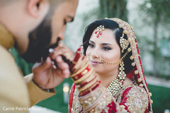 Glamorous Indian bride looking at groom capture.