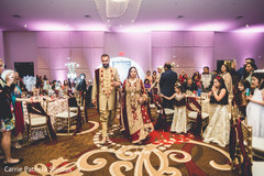 Indian bride and groom entering the wedding reception.