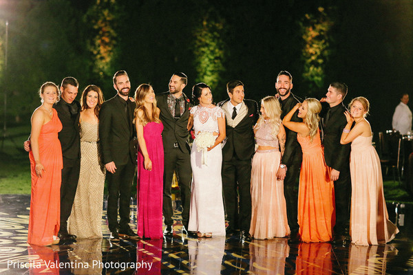 Lovely indian couple posing outdoors with bridesmaids and groomsmen
