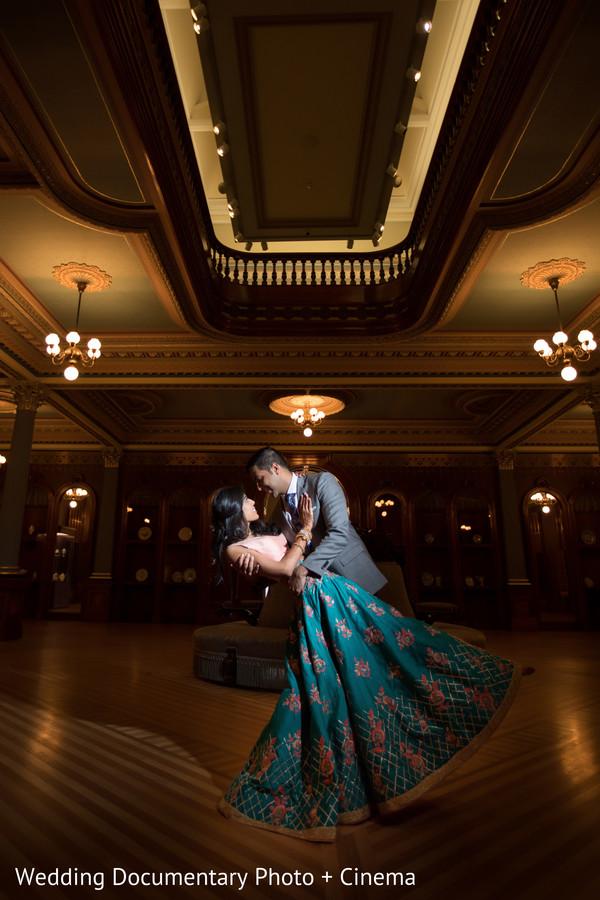 Dreamlike portrait of Indian bride and groom dancing capture.