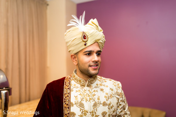 Gorgeous Indian groom ready with his wedding ceremony oufit.