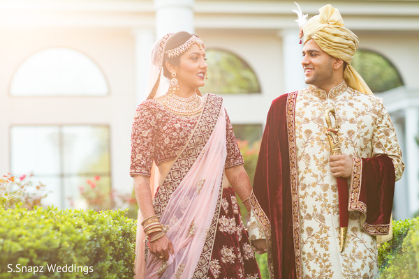 Dreamy Indian bride and groom outdoors capture.