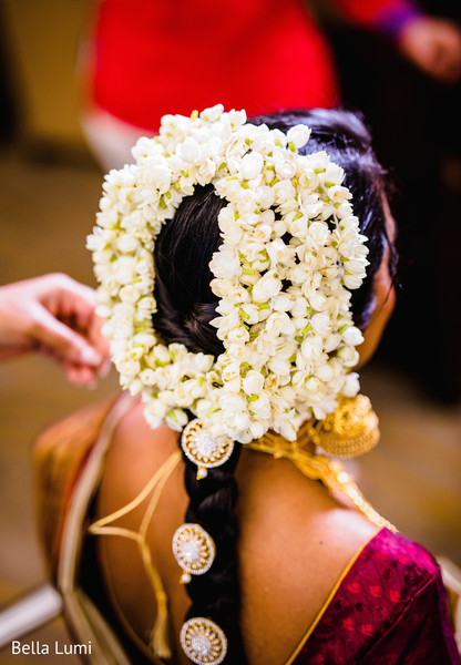 Gorgeous Indian bride's flowers hair decoration.