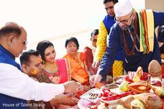 Indian bride and groom pre-wedding ritual