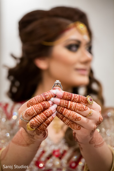 Indian bride showing engagement ring