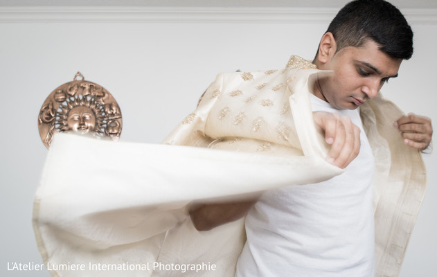 Indian groom getting ready scene