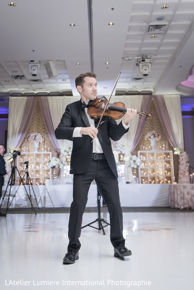 Violin player during wedding reception