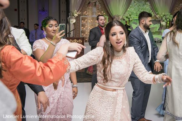 Dazzling indian bride rocking the dance floor