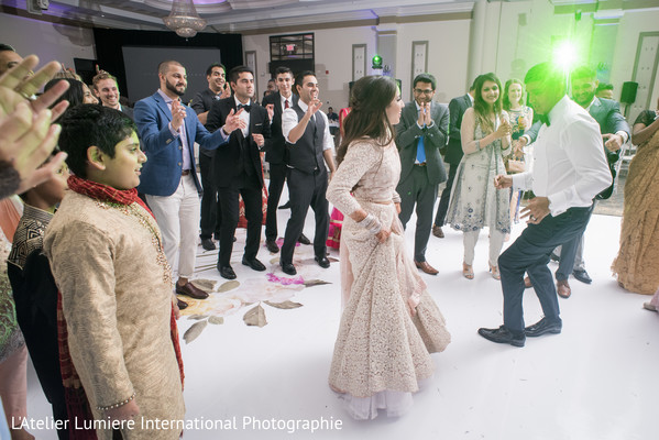 Indian newlyweds dancing photography