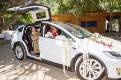 Indian groom inside wedding car