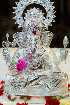 Stunning Indian ceremony Ganesha Puja decoration.